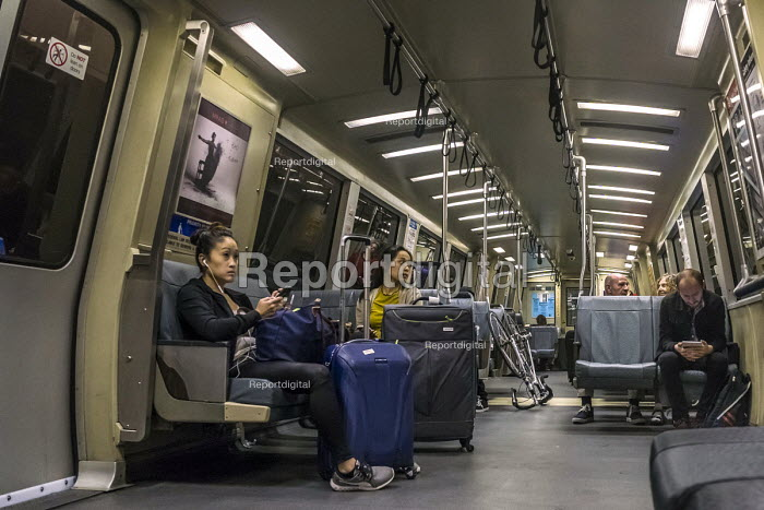 San Francisco, California, USA: Passengers on the Bay Area Rapid Transit train between San Francisco and Oakland as they go through the tunnel beneath San Francisco Bay - David Bacon - 2018-06-09