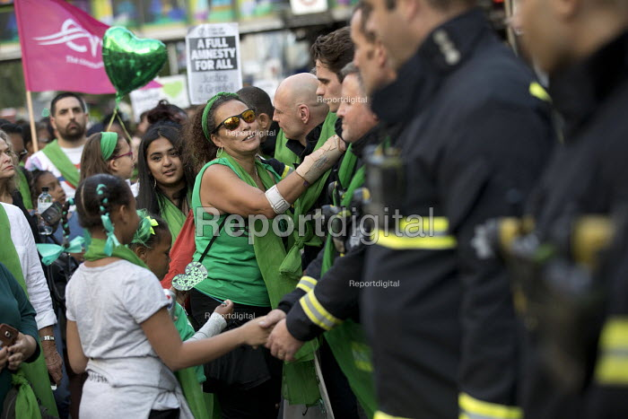 Local community thanking the firefighters. Silent march in memory of the victims of Grenfell Tower fire on the first anniversary, Kensington, London - Jess Hurd - 2018-06-14