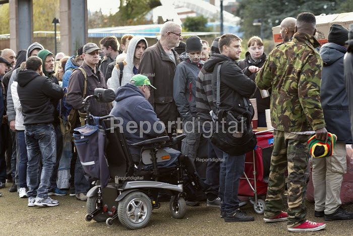 Homeless, disabled and hungry queuing for food, Coventry. The soup kitchen and food bank is provided by The Midland Langar Seva Society - John Harris - 2017-11-05