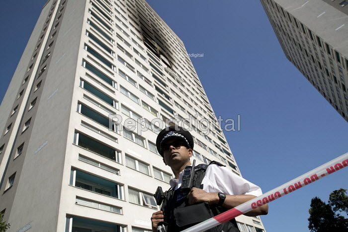 Police officer, Grafton House where a twelfth floor fire is contained and brought under control by over 50 firefighters at a 22 story East End Homes tower block in Mile End, East London - Jess Hurd - 2018-06-29