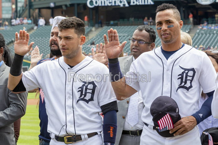 Detroit, Michigan USA Immigrants are sworn in as new US citizens in a ceremony before a Detroit Tigers baseball game, Comerica Park. Tigers shortshop Jose Iglesias (L) and center fielder Leonys Martin, both of whom defected from Cuba, were among the new citizens - Jim West - 2018-06-25