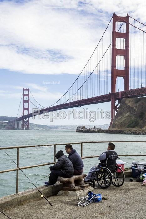 San Francisco, California, USA: Fisherman under the Golden Gate Bridge - David Bacon - 2018-07-07