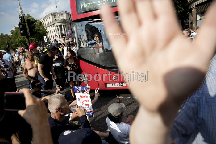 Pro Trump and Tommy Robinson supporters blocking a bus intimidating a Muslim women driver, Whitehall, London - Jess Hurd - 2018-07-14