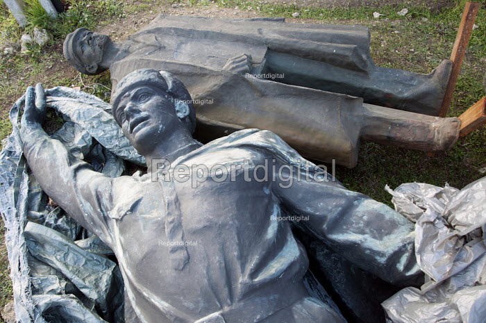 Disgarded Soviet era statues, including one of Lenin, laying outside Memento Park Museum Budapest, Hungary - Janina Struk - 2014-01-02