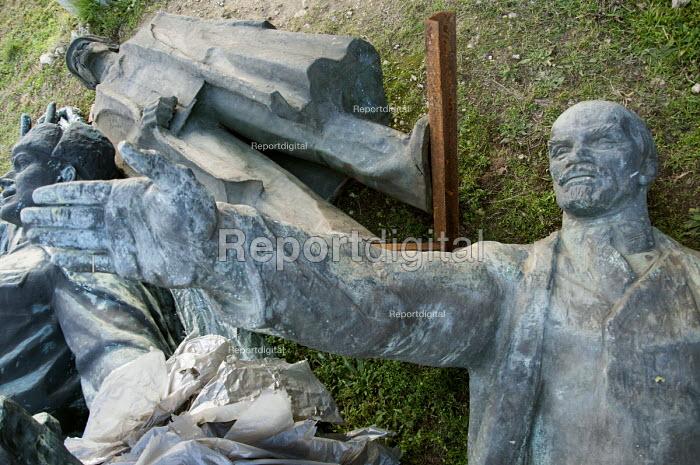 Disgarded Soviet era statues, including one of Lenin, laying outside Memento Park Museum Budapest, Hungary - Janina Struk - 2014-01-02