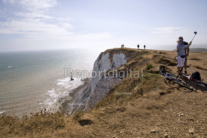 Tourists taking selfies, Beachy Head, a Chalk headland and suicide spot in East Sussex - Jess Hurd - 2018-07-28