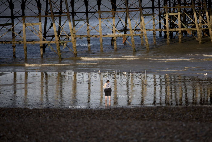 Woman paddling under Eastbourne Pier, East Sussex - Jess Hurd - 2018-07-28