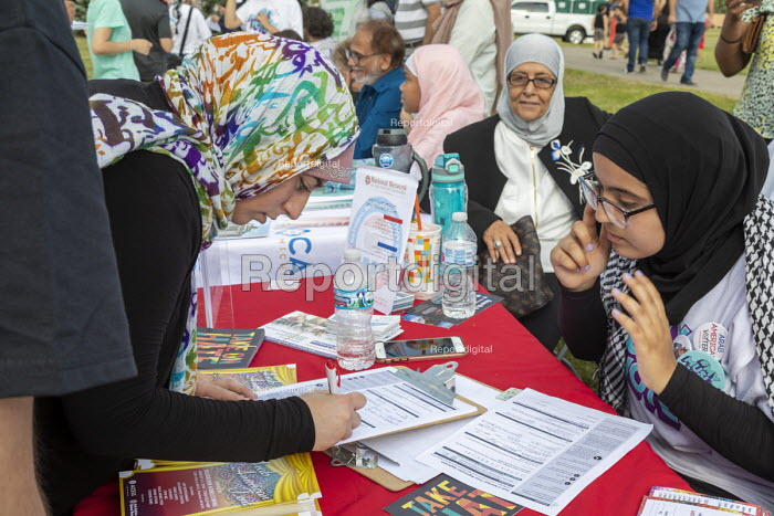 Dearborn, Michigan USA: Woman registering to vote, Muslim Get Out the Vote rally, sponsored by several Muslim community organisations - Jim West - 2018-07-29
