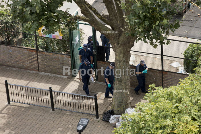 Police forensic team searching a local nursery school after a stabbing of a teenager, Knapp Road, East London - Jess Hurd - 2018-08-04