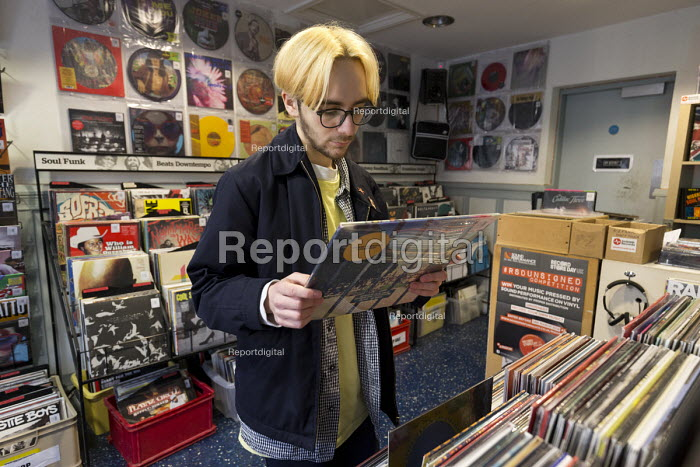 Teenager browsing in a record shop, Leamington Spa, Warwickshire - John Harris - 2018-02-15