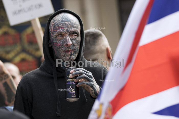 EDL national protest Worcester. Man with fascist tattoo including C18 on his eyelid and a swastika on forehead drinking illegally - Jess Hurd - 2018-09-01