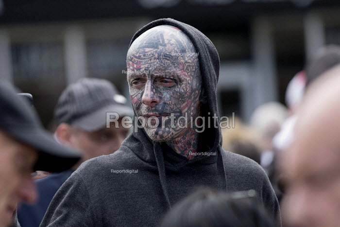 EDL national protest Worcester. Man with fascist tattoo including C18 on his eyelid and a swastika on forehead - Jess Hurd - 2018-09-01