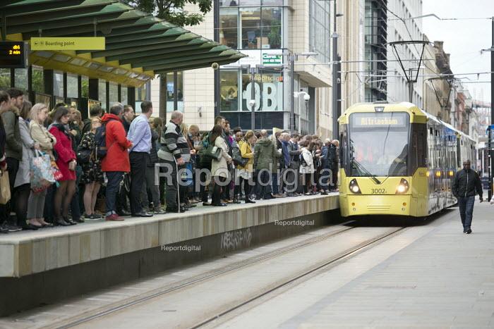 Passengers waiting as a tram arrives at a stop, Manchester - John Harris - 2018-09-10