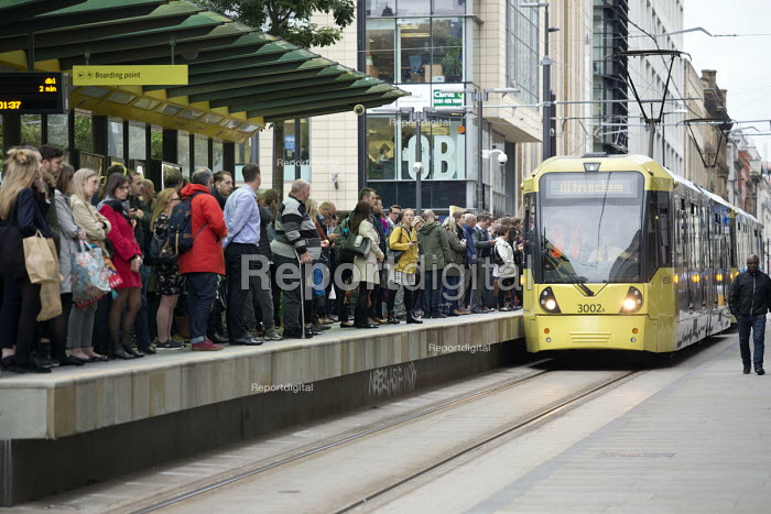 Passengers waiting as a tram arrives at a stop, Manchester - John Harris - 2018-09-10