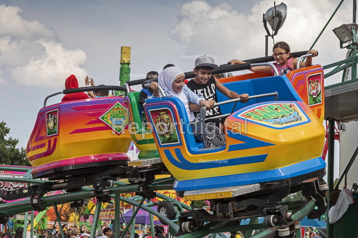 Dearborn, Michigan USA Arab-American children ride the Jungle Twist carnival ride at the annual Dearborn homecoming festival. Nearly half of Dearborn's residents are Arab-Americans, mostly Muslims. - Jim West - 2018-08-05