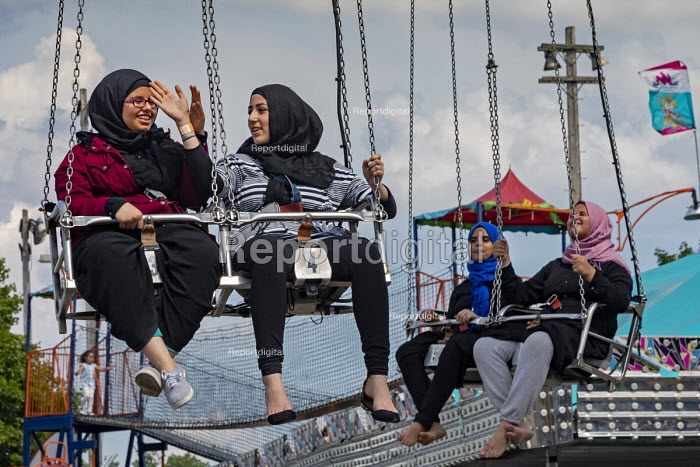 Dearborn, Michigan USA Young Arab-American women on the carnival ride, Annual Dearborn homecoming festival. Nearly half of Dearborn's residents are Arab-Americans, mostly Muslims - Jim West - 2018-08-05