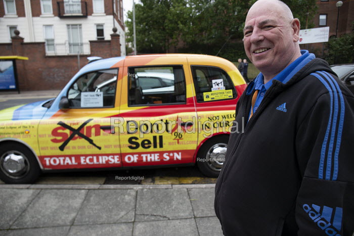 Taxi Driver with his black cab Total Eclipse of The Sun newspaper still boycotted for coverage of the Hillsborough disaster, Liverpool - John Harris - 2018-09-22
