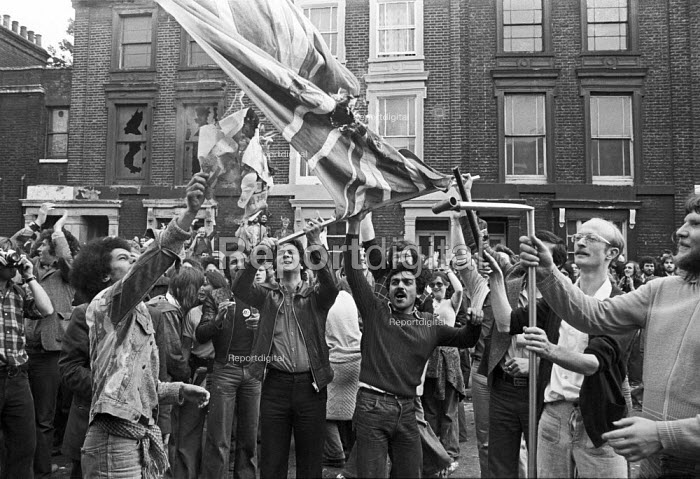Battle of Lewisham 1977. Protest against the National Front march burning a captured NF banner - NLA - 1977-08-13