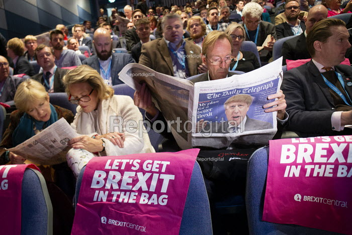 Delegate reading The Daily Telegraph with Boris Johnson front page, Making a Sucess of Brexit fringe meeting, Conservative Party Conference Birmingham 2018 - John Harris - 2018-09-30