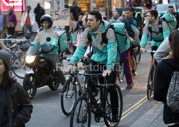 Take away food delivery workers strike for better pay, Bristol. The workers want a minimum of £5 per delivery, paid waiting times at restaurants of 17p per minute, a freeze on hiring new riders and greater transparency in the app on activity levels - Paul Box - 2018-10-04