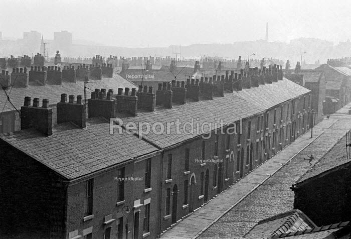 Blackburn, Lancashire 1970. Boy playing football in deserted street - NLA - 1970-02-27