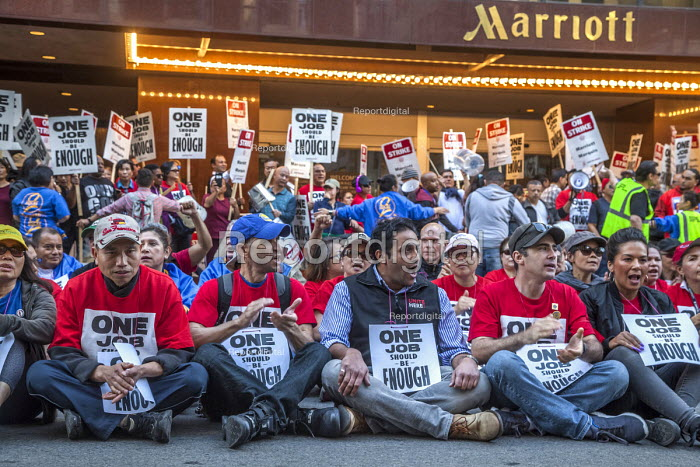 San Francisco, USA Hotel workers striking against low pay sit-in outside Marriott Marquis Hotel. The low wages force many workers to work an additional job - David Bacon - 2018-10-12