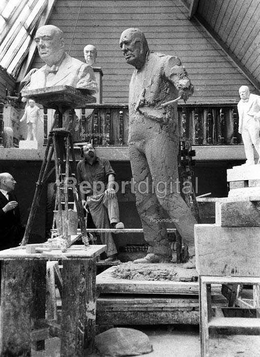 Simon Guttmann (L) Secretary of Report talking to Sculptor David McFall working on his statue of Sir Winston Churchill, Chelsea, London 1958. The sculpture is to to be cast in bronze and placed at the edge of Epping Forest in Churchill's constituency of Woodford. McFall was the last sculptor to model Churchill from life. Guttmann accompanied Report photogaphers to their assignments to engage subjects in conversation as a means of ensuring photos of them were never posed direct to camera - Alan Vines - 1958-12-04