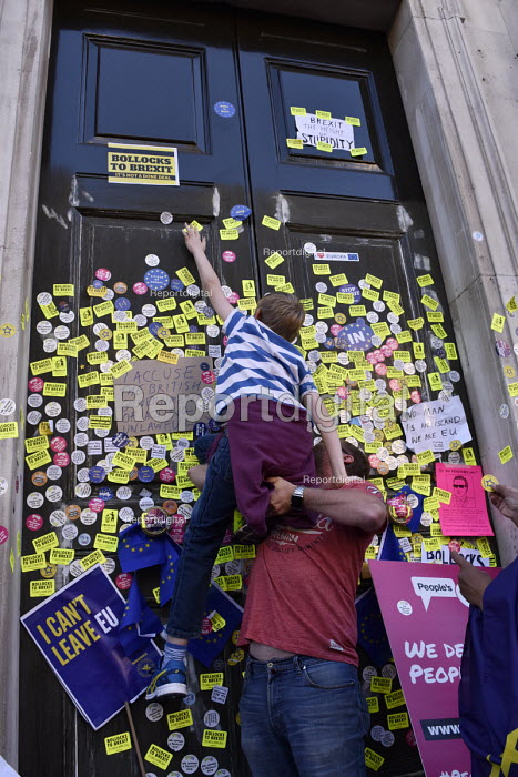 Peoples Vote March for the FutuPeoples Vote March for the Future. London protest demanding a second referendum on the Brexit deal Protestors cover the door of the Cabinet Office in Whitehall with anti-Brexit stickers - Stefano Cagnoni - 2018-10-20
