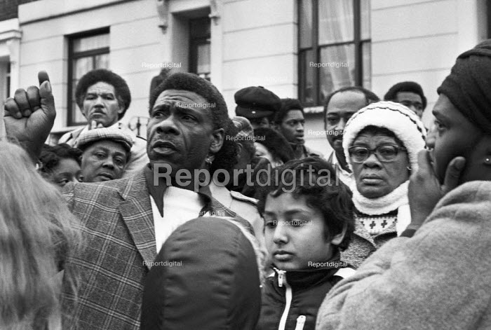 New Cross fire, where 13 young people died Deptford London 1981. The blaze broke out from inside the house, either accidentally or deliberately, during a birthday party at the house, Sout East London. Angry and shocked local residents outide the house the morning after - Peter Arkell - 1981-01-18