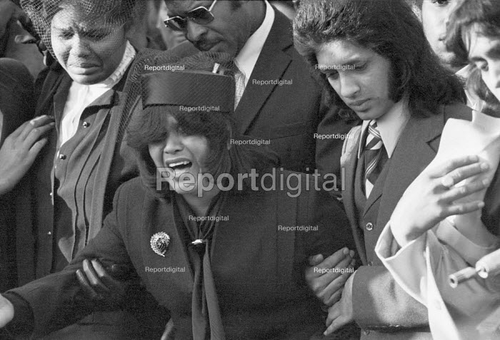 Funerals of Yvonne Ruddock and Paul Ruddock victims of the New Cross house fire London 1981. Their mother and other relatives are grief stricken - Peter Arkell - 1981-02-11