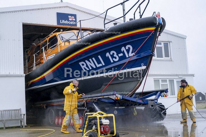 RNLI crew cleaning lifeboat, Dungeness Lifeboat station, Kent - Jess Hurd - 2019-01-01