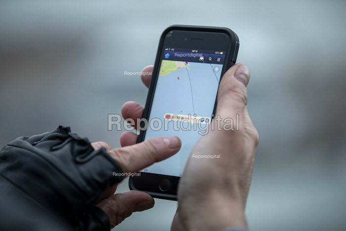 Press photographer tracking the boarder patrol boat Searcher, looking for refugees crossing the Channel Channel from France, Port of Dover, Kent. - Jess Hurd - 2019-01-01