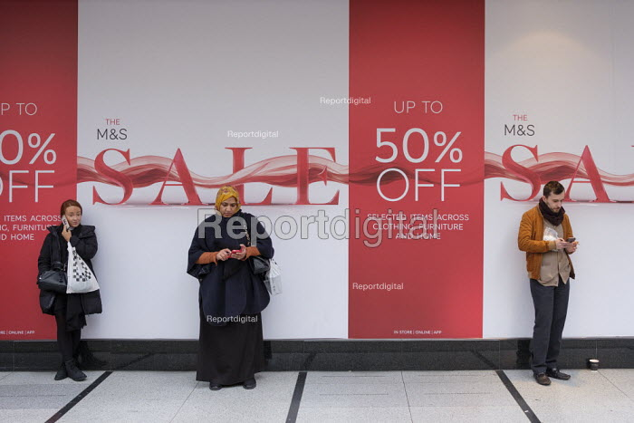 Shoppers with mobile phones waiting, Marks & Spencer store end of year sale, Oxford Street, London - Philip Wolmuth - 2019-01-02