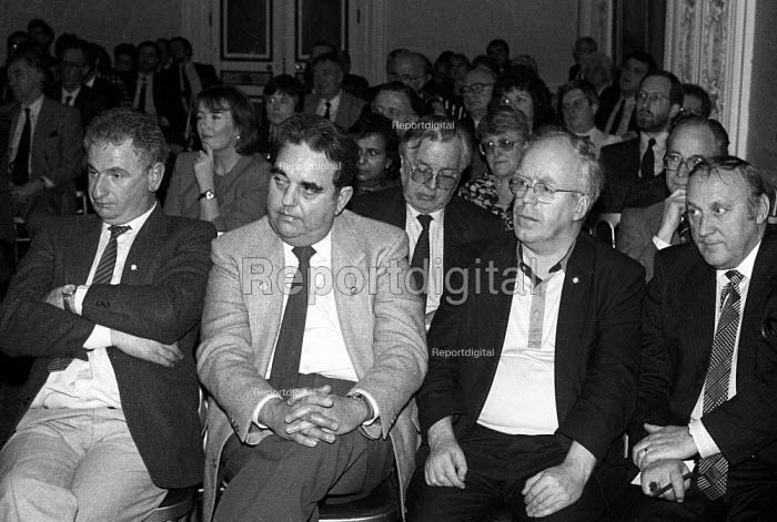 GCHQ Civil Servants sacked for refusing to give up union membership, London 1991, listening to the FDA sponsored GCHQ lecture given by Brenda Dean Gen Sec of SOGAT. Mike Grindley (R) Liz Symonds FDA Gen Sec listening in 2nd row - Stefano Cagnoni - 1991-03-07