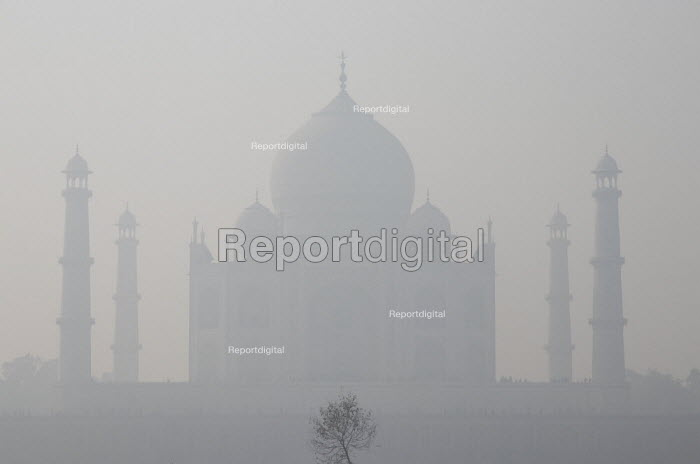 Air pollution in India, The Taj Mahal in thick smog, Agra. Air pollution in India is a serious issue with the major sources being fuelwood and biomass burning, fuel adulteration, vehicle emission and traffic congestion - Martin Mayer - 2018-11-08