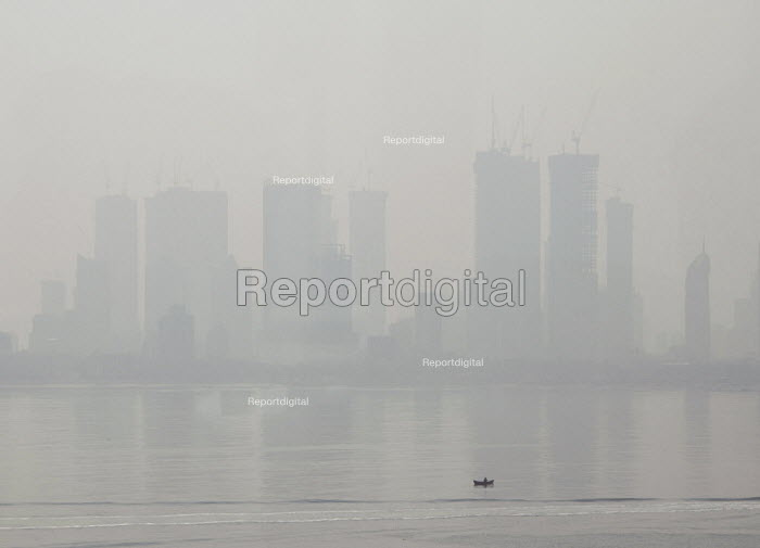Air pollution in India, Mumbai; High rise buildings through morning smog. Mumbai as the fourth most polluted city in the world. Air pollution in India is a serious issue with the major sources being fuelwood and biomass burning, fuel adulteration, vehicle emission and traffic congestion - Martin Mayer - 2018-11-11