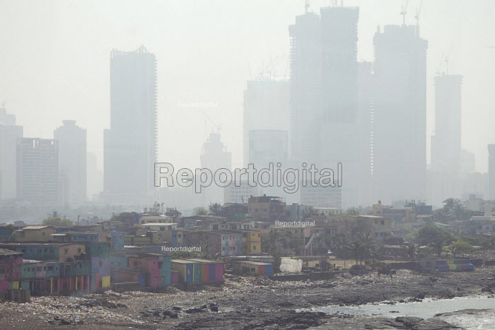 Air pollution in India, Mumbai: Extremes of wealth, slums and new high rise flats in smog. Mumbai as the fourth most polluted city in the world. Air pollution in India is a serious issue with the major sources being fuelwood and biomass burning, fuel adulteration, vehicle emission and traffic congestion - Martin Mayer - 2018-11-11