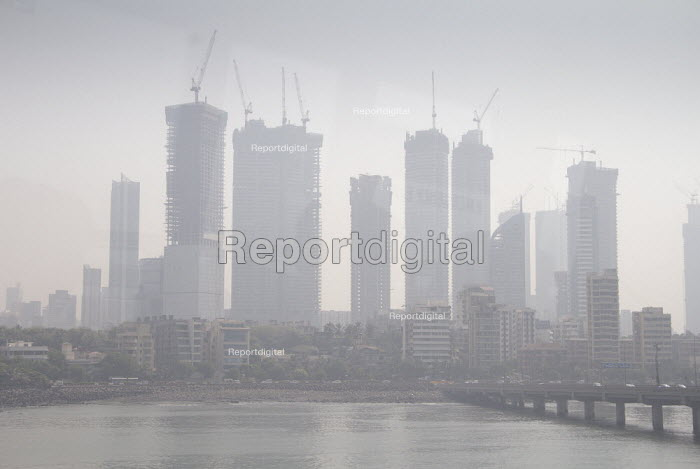 Air pollution in India, Mumbai; construction of high rise buildings in smog. Mumbai as the fourth most polluted city in the world. Air pollution in India is a serious issue with the major sources being fuelwood and biomass burning, fuel adulteration, vehicle emission and traffic congestion - Martin Mayer - 2016-08-28