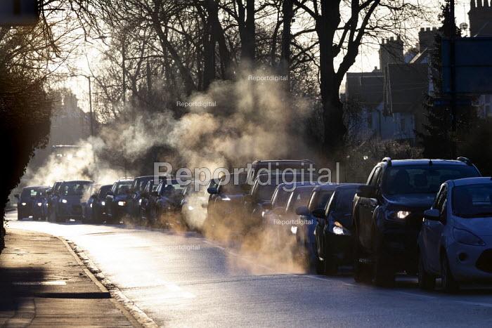 Early morning light catching exhaust emissions. Traffic congestion, Stratford upon Avon, Warwickshire - John Harris - 2019-01-30