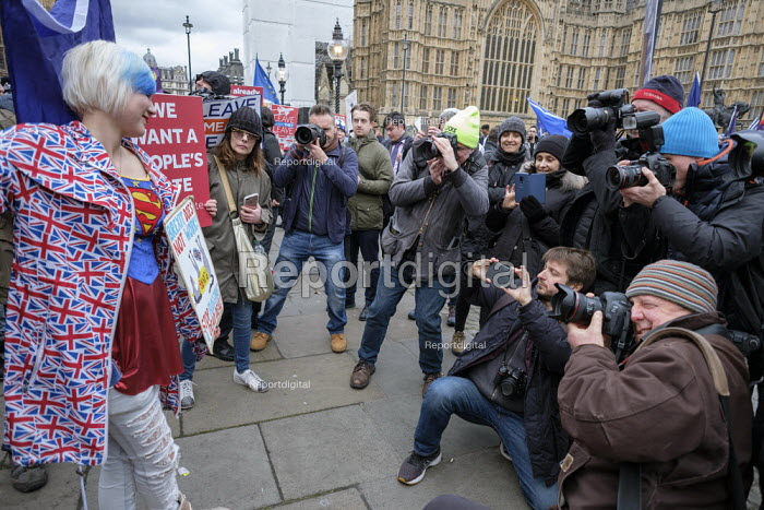 Photographers surrounding a young woman anti-Brexit protestor outside the Houses of Parliament as MPs vote on amendments to EU withdrawal deal, Westminster, London - Philip Wolmuth - 2019-01-29
