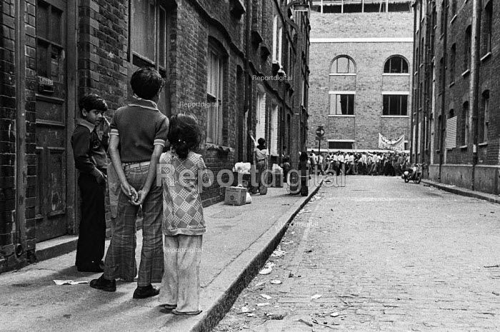 Asian children watching an Anti Nazi League protest passing the end of their street London 1978 - John Sturrock - 1978-06-18