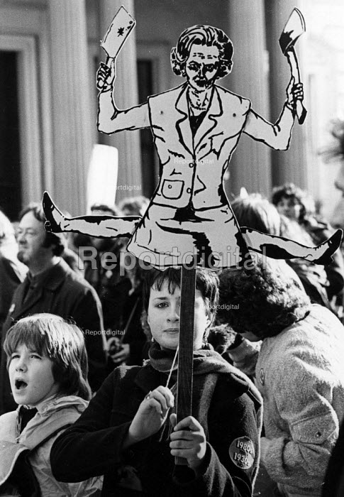 Protest against cuts, cardboard cut out of Margaret Thatcher wielding her axe London 1980 - John Sturrock - 1980-03-09