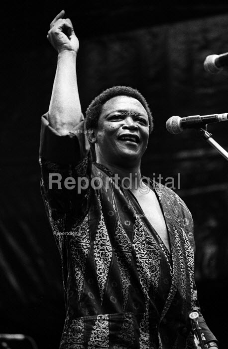 Hugh Masekela, Artists Against Apartheid free music festival Clapham Common London 1986. After a March and Rally in London against apartheid in South Africa artists stage a free concert in support of the Anti-Apartheid Movement and for an end to apartheid and for freedom in Namibia & South Africa - Stefano Cagnoni - 1986-06-28