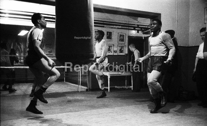 Nigerian boxer Dick Tiger right in training at the gym with other boxers LIverpool 1958 - Alan Vines - 1958-10-13