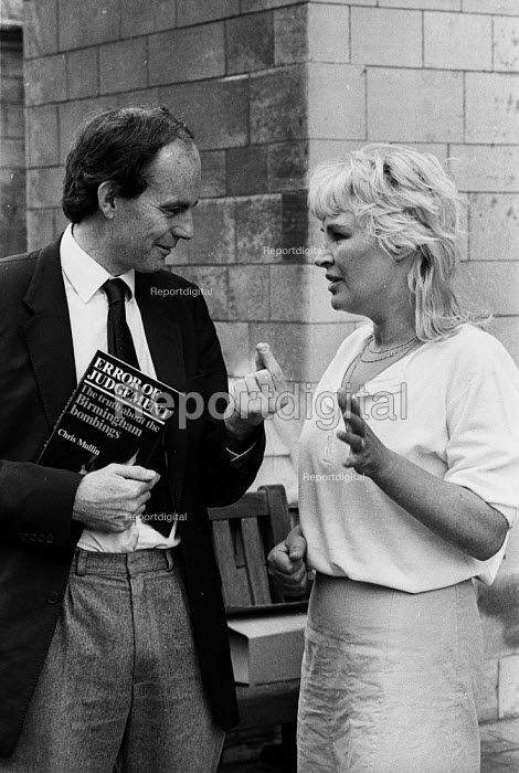 Chris Mullin with his newly published book Error of Judgement London 1986. 'Error of Judgement - The truth about the Birmingham Bombings' eventually led to the correction of one of the biggest miscarriages of justice in British legal history. Chris MUllin with Patsy Power sister of Billy Power one of the 6 men wrongly convicted for the bombing - Stefano Cagnoni - 1986-07-14