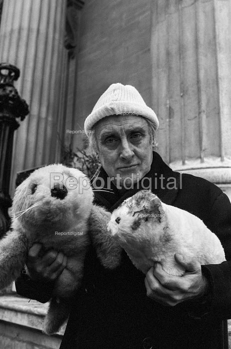 Spike Milligan Animals' Vigilantes protest against seal culling 1981. Actor Spike Milligan lobbying against culling seal pups for their fur, Canada House, London. They presented a petition of 190,000 signatures protesting against the annual Seal Kill in Canadian waters. In 1980 170,000 baby Harp seals were slaughtered. Spike Milligan holds up dummy baby seals during the protest outside Canada House, Trafalgar Square, London - Martin Mayer - 1981-02-19
