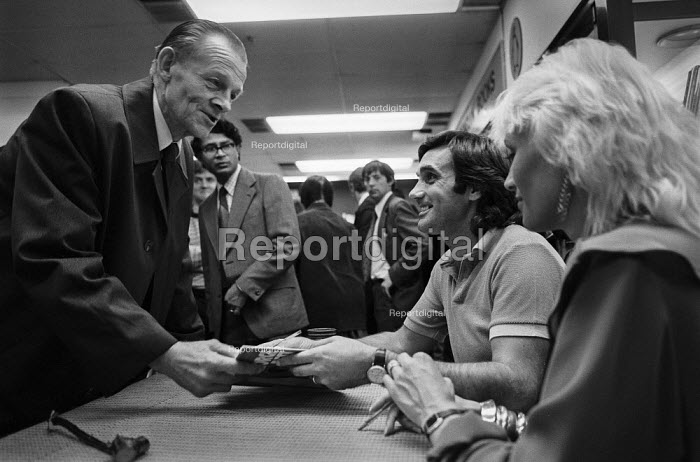 George Best, book signing London 1981 with his wife Angie. - Martin Mayer, MM1901228.jpg