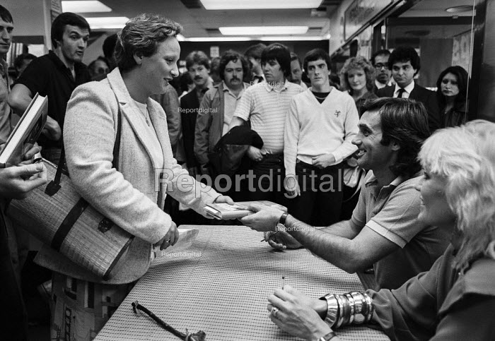 George Best, book signing London 1981 with his wife Angie. - Martin Mayer, MM1901230.jpg