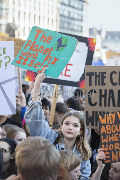 Climate strike students blocking the roads around Parliament Square, Westminster, London. - Jess Hurd - 2019-02-15