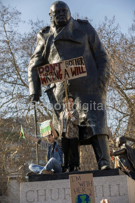Climate strike students on Churchill statue, Parliament Square, Westminster, London. - Jess Hurd - 2019-02-15